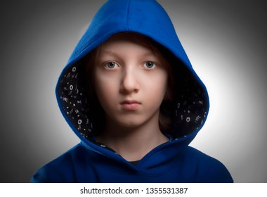 Portrait of a Boy with Brown Hair in Blue Hood.