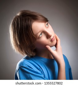 Portrait of a Boy with Brown Hair Thinking.