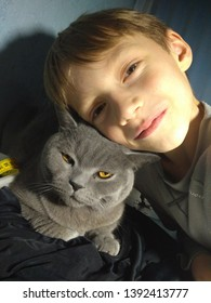 Portrait of a boy with cat.