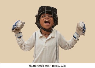 Portrait of boy celebrating his success in cricket