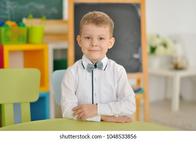 A portrait of a boy in a children's room.