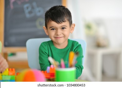 Portrait of a boy in the classroom.