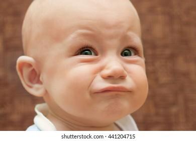Portrait of a boy close up, tears