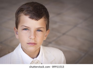 Portrait of boy dressed in suit. Shallow depth of field, slight vignette
