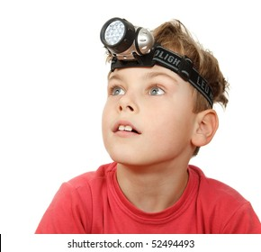 Portrait of boy with flashlight on his head on white background. Looks aside.