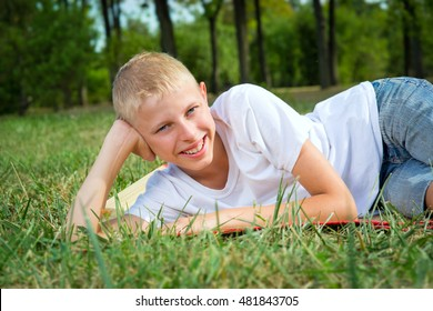 Portrait of a boy fourteen years of age in the grass