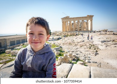 Portrait of boy in front of Parthenon of Acropolis, Athens, Greece