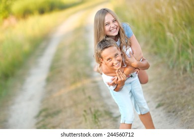 Portrait of a boy and girl on the field in summer