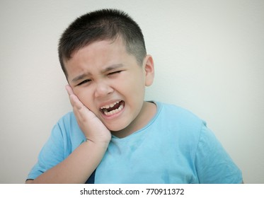 Portrait boy has a toothache.Oral Care Concepts