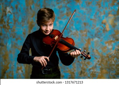 A portrait of a boy in his teens playing the violin. A creative, talented, gifted boy.