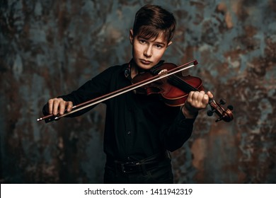 A portrait of a boy in his teens with the violin. A creative, talented, gifted boy.