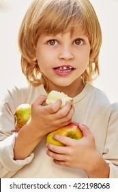 portrait Boy holding apples