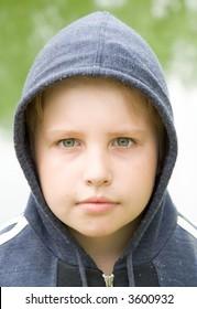 portrait. boy in hood