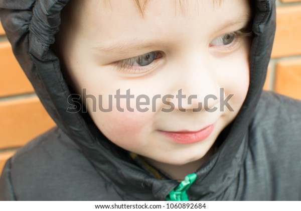 portrait of a boy in a hood jacket