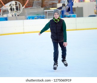 Portrait of a boy in ice skating ring