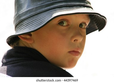 Portrait of the boy in a leather hat