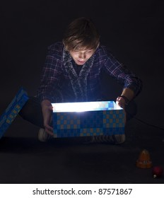 Portrait of a boy looking in a magic lighting box