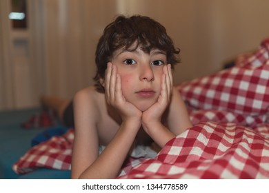 Portrait of a boy on the bed.