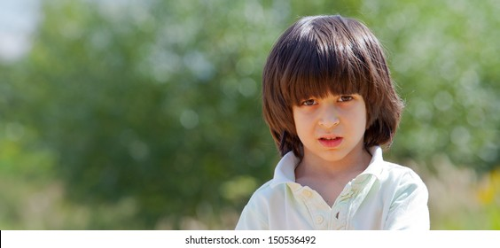 Portrait of a boy on a green background