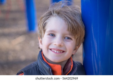 Portrait of a boy on playground
