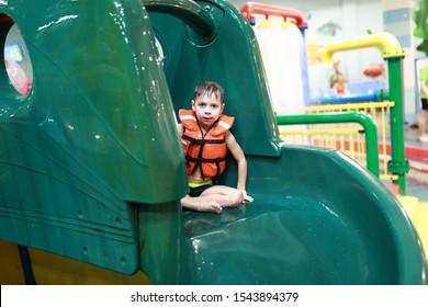 Portrait of boy on a water slide