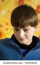 Portrait of boy on a yellow floral backgound