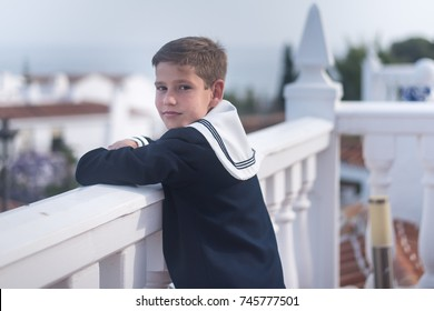 Portrait of a boy outdoors on his first holly communion
