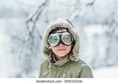 Portrait of a boy outdoors in winter