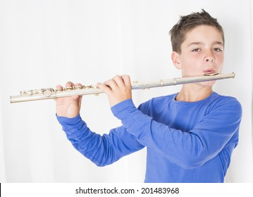 portrait of a boy playing the flute