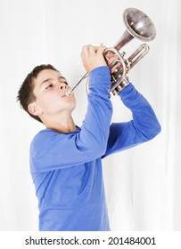 portrait of a boy playing the trumpet