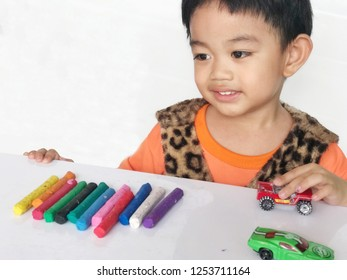 portrait of boy playing young with modeling clay or play dough