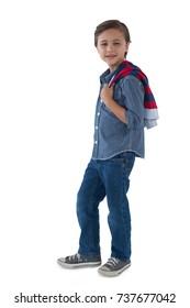 Portrait of boy posing against white background