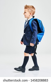 Portrait of a boy ready to school isolated on white