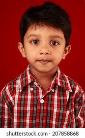 Portrait of a boy in red background