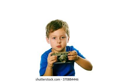 portrait of a boy with retro camera