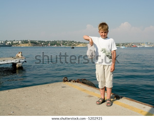 Portrait of a boy with sea at background