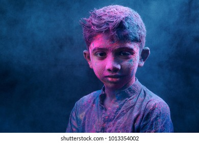 Portrait of a boy smeared with colors.Concept for Indian festival Holi.