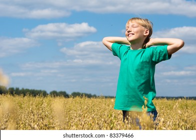 portrait of a boy standing at field