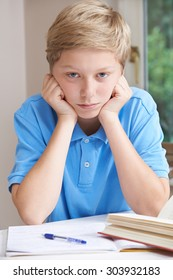Portrait Of Boy Struggling With Homework