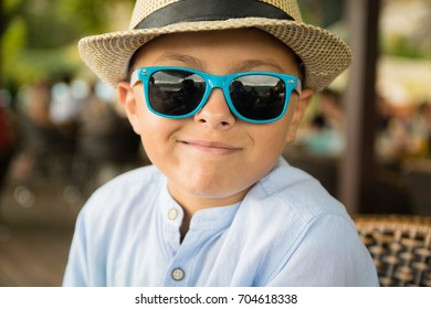 Portrait of a boy with sunglasses and hat