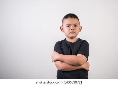 Portrait of boy thinking something in studio photo