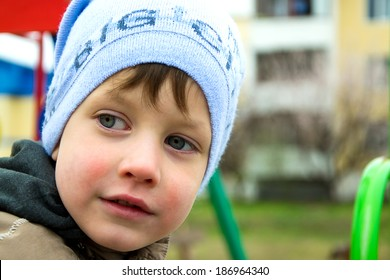 portrait of boy in warm hat