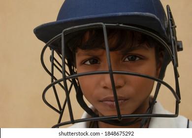 Portrait of boy wearing cricket Helmet