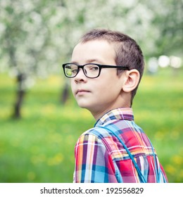 Portrait  boy wearing glasses against the nature of spring