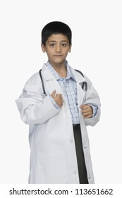 Portrait of a boy wearing lab coat and holding a stethoscope