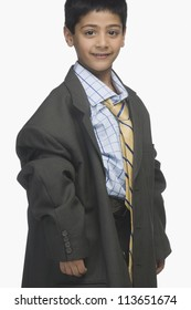 Portrait of a boy wearing oversized business clothing