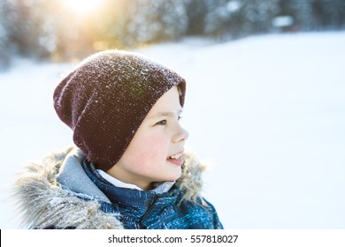 portrait of a boy in winter forest