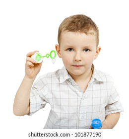 A portrait of boy without bubble soap. The boy looks straight at the camera. He is preparing to blow bubbles. It is focused.