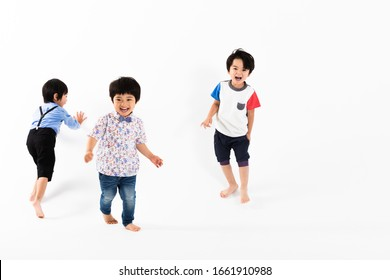 Portrait of boys in front of white wall