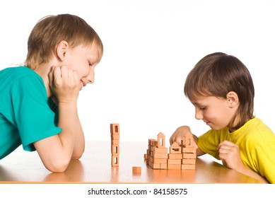 portrait of a boys playing at table